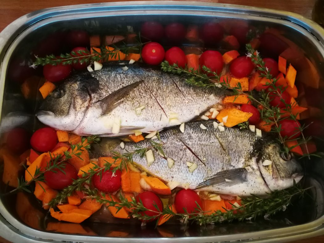 Gilt head with pumpkin and tomatoes