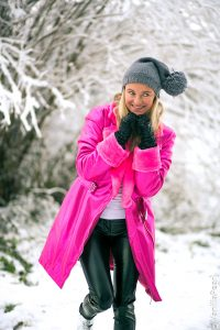 Christina with a pink fakefur winter coat from Arcanum
