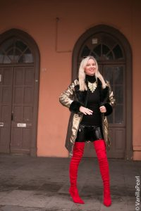 Christina with a golden winter coat and black vinyl pants from Arcanum