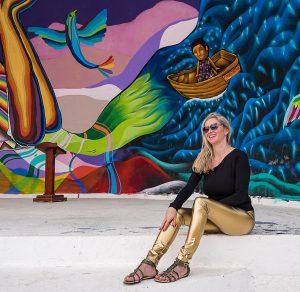 Christina with golden vinyl leggings