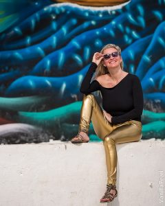 Christina with golden vinyl leggings in Holbox Mexico