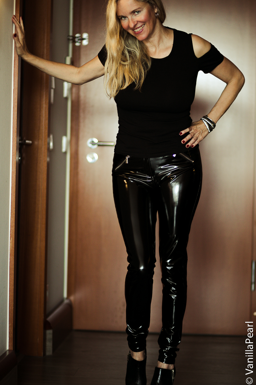 Christina with black vinyl pants
