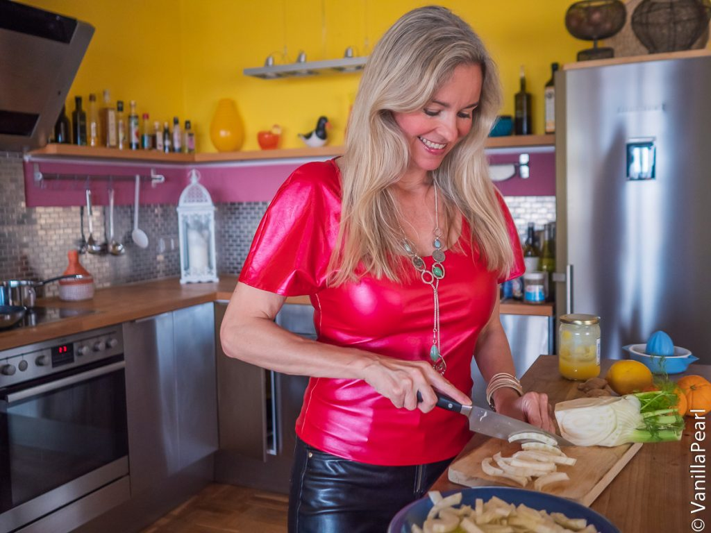 Christina Striewski Vanillapearl is cooking in her kitchen and wearing self-made fake leather .